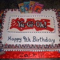 Grandson's Yu-Gi-Oh Birthday Cake My grandson saw this cake on CC made by Mariamom and begged me to make one for him! This is a strawberry cake w/BC. Choclate transfer that...