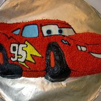 "Car This cake was made a local charity race to beat cancer. It's white cake with buttercream. Based from the movie ""Cars""."