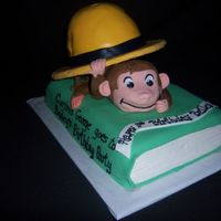 Curious George This is my first attempt at a Curious George cake. The book and the hat are yellow cake. George is RKT. The hat was made with the...
