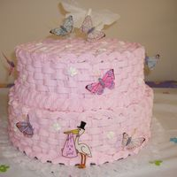 Butterflies Pink buttercream cake with butterflies. This cake was for a babyshower.