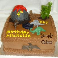 Dinosaur Cake Chocolate Cake w/choc buttercream with dollar store toys