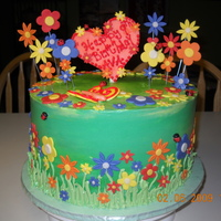 Ava's Garden Cake For my friend's daughter's 9th bday. Covered with SMBC and flowers are from fondant.
