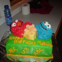 Birthday Cake Disaster I made this for a friend and about an hour after I made it Elmo and Cookie Monster started falling apart. They were made from Rice Krispie...