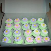 Easter Cupcakes Chocolate and Yellow cupcakes. BC frosting royal icing Daisies.