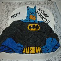 Batman I work at a residential treatment center for children who may not have families and have behavioral problems. It is a yellow cake iced in...