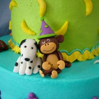 Monkey Dog Cake - The Back Here is the back of the cake. I had a fit making the little monkey - as he dried he began to lean over and then his ear fell off. In the...