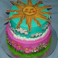 Sun And Flowers This is my daughter's birthday cake. She chose a design from my WBH book and I tweaked it a little.