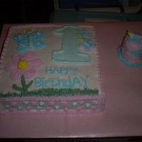 First Birthday Cake With A Small Smash Cake This is my version of a cake my customer found off of CC. I found out I really can't make butterflies very well. Also, the birthday...