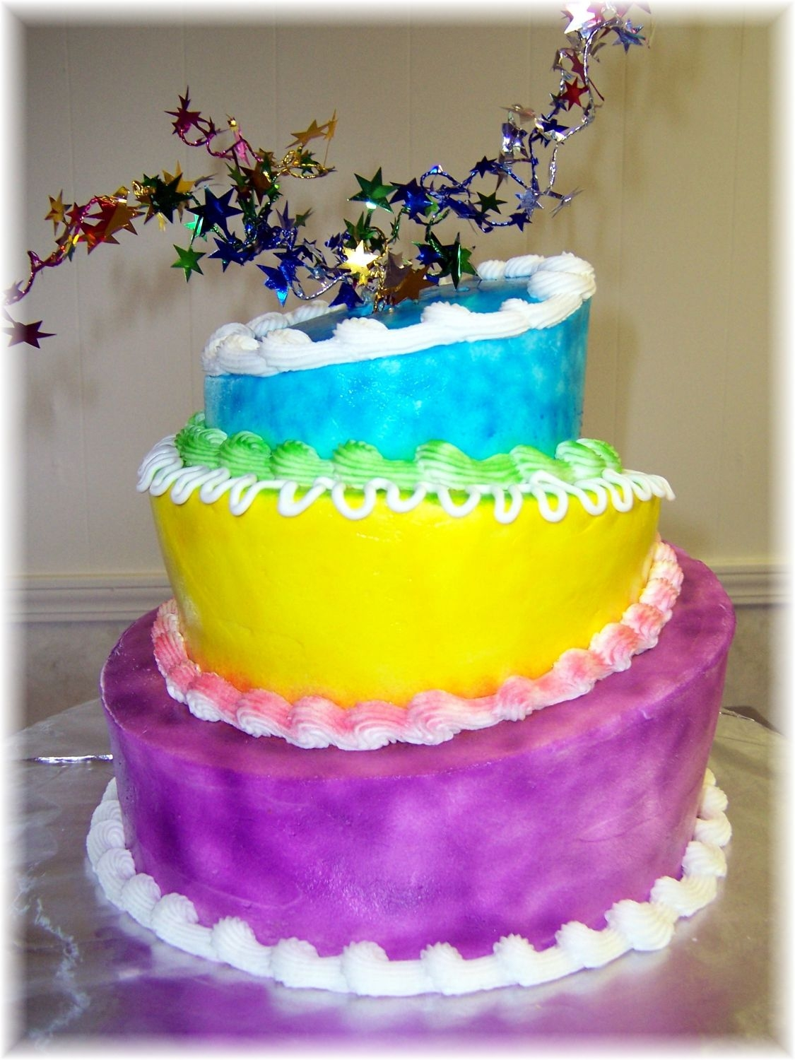 Celebrate Mad Hatter Style buttercream cake with airbrushed color
