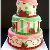 Strawberry Shortcake buttercream with fondant decorationsThanks for all the ideas here on CC