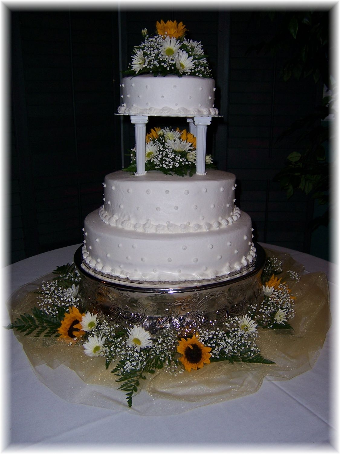 Sunflower_Simply_Devoted.jpg three tiered buttercream cake with fresh sunflowers and daisys