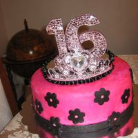 Meli's Sweet Sixteen This cake was made for my sister's sweet sixteen. It was a chocolate cake with choclate ganash. It was also my first attempt at...