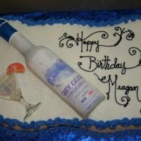 Vodka Cake I made the bottle out of fondant and put an edible image on it. The inside of this cake is tinted blue also.