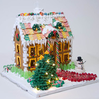 Colonial Gingerbread Bob Vila house plans, sugar windows, lit inside and trees have lights. It was a blast to make this and next year I'm doing my own...