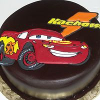 Logan Loves Lightning Mcqueen First birthday cake, lemon with chocolate fondant and royal icing color flow / runout plaque of Lightning McQueen. I made my first smash...