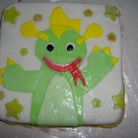 Baby Einstien Dragon I made this as a birthday cake for my daughter's first birthday. It's my first try with fondant.