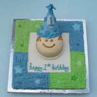 "1St Birthday Boy! This was my son's first birthday cake. It was a duplication of the theme for the party. The cake is a 16"" square with a 6""..."