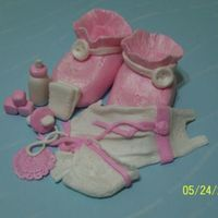 Close Up Of Girl Items On Baby Shower Cake   all made from fondant with lusterdust