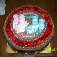 Baby Shower Cake  Cake made for two sisters - 1 having a girl, 1 having a boy. Cake is chocolate buttercream and items on top are fondant. Strawberries...