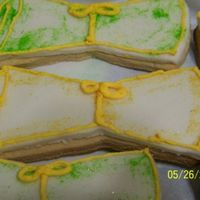 Diploma Cookies  Rolled out cookies from wilton with rolled buttercream, royal icing accents and sparkle dust. Went with the green graduation caps and the...