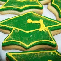 Graduation Cap Cookies   Rolled out cookies from wilton and rolled buttercream with royal icing accents.