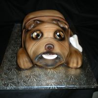 Bulldog Carved from 2 sheet cakes in a class with Bronwen Weber. Covered in fondant and then airbrushed. TFL!