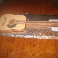 Accoustic Guitar The neck of the cake is fondant covered RKT.