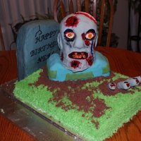Zombie Cake This is the cake I made for my husbands 40th birthday. He absolutely loves zombies. All of it is cake except for the fingers ,those are RKT...