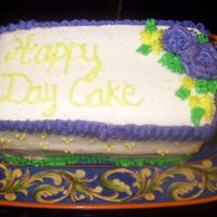 Happy Day Cake  Ok, this doesn't look like much, but it tasted good. It is an 8x8 cut in half (I just eyeballed it so the layers aren't the same...