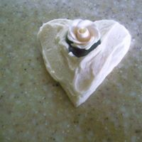 Lizzie_039.jpg Rehersal Dinner Cookies. Heart cutouts with rough ivory butter cream and ivory gumpaste roses.