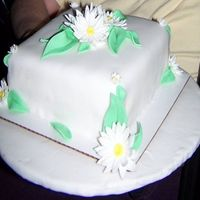 Fondant And Gumpaste Final vanilla cake, orange buttercream filling and undercoat, daisies and leaves