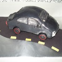 Picture_046.jpg My first car cake. Ive learned so much from this cake, im sure the next one will be even better. With help from CC members, Thank you
