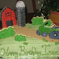 Isaac's Farm Birthday Color Flow covered sugar cookies decorate this farm themed cake for my nephew's birthday. A big hit with the kids-- can't beat...