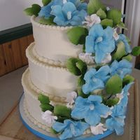 Hawaiian Wedding Gumpaste Hibiscus, fruit blossoms and leaves. Buttercream frosting over vanilla cake