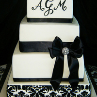 Black And White Damask Piping done with royal icing. Damask is with stencil. Ribbon is satin.