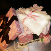Lingerie Gift Box Cami is cut from fondant. Styrofoam used for lid. Tissue paper is made from gum paste.