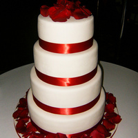 Red And White Wedding Cake A simple red and white design. Satin ribbon. Real rose petals.