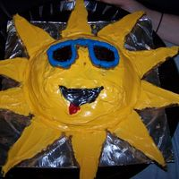 Sun Cake! The sun is a dome shaped cake and the sunglasses and rays are chocolate chip cookies with frosting.