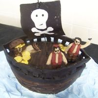 Pirate Ship Had sooo little time to bake this.. the figures didn't dry and the started 2 fall over :p luckily just 4 family.. Choc cake, gumpaste...