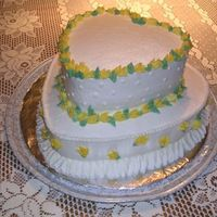 Course 3 Final Cake  My first tiered cake! The top tier is lemon, the bottom tier is white. Unfortunately, with the 97 degree heat, my last class got cancelled...
