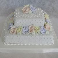 A Square Wedding Cake With Roses