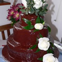 Chocolate With White Roses A three tier wedding cake with chocolate fudge icing and real white roses