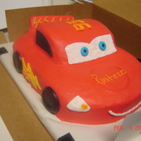 Lightening Mcqueen Super fun cake to do. Carved from a 9x13 and 2 loaf cakes. Client loved it. All buttercream but the wheels are chocolate. The fen is cake...