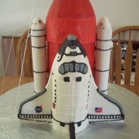 Space Shuttle  Chocolate cake with raspberry pear filling for the main engine. WASC with raspberry filling for the shuttle and card board tubes covered in...