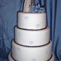 Intertwined Hearts   Chocolate cake with white truffle ganache filling. Royal icing hearts. Fondant oval pearl border