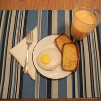 April Fool's Breakfast  Sugar cookie fried egg, pound cake was sliced, buttered, sprinkled with brown sugar, and toasted in the oven. Milk colored orange to look...