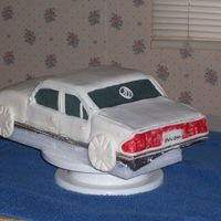 Grand Marquis here is a practice cake ..its to be a grooms cake.. this is my first car cake. I'm to make one for a grooms cake thats why its all...