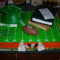 Graduation Cake a young boy with cancer just graduated. his mother wanted to show his achievements ..so she wanted football, theater, books and of course...