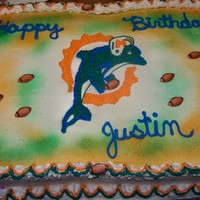 Miami Dolphins Made this for the boy down the street. Half white Half Chocolate. Did a piping gel transfer then piped it in. TFL.