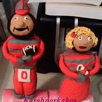 Mr And Mrs Brutus Buckeye   Made out of rice cripsy treats and covered in fondant. Made for a couple that is renewing their wedding vows. Hope they like it. TFL!